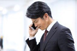 Japanese apologizing over the phone image